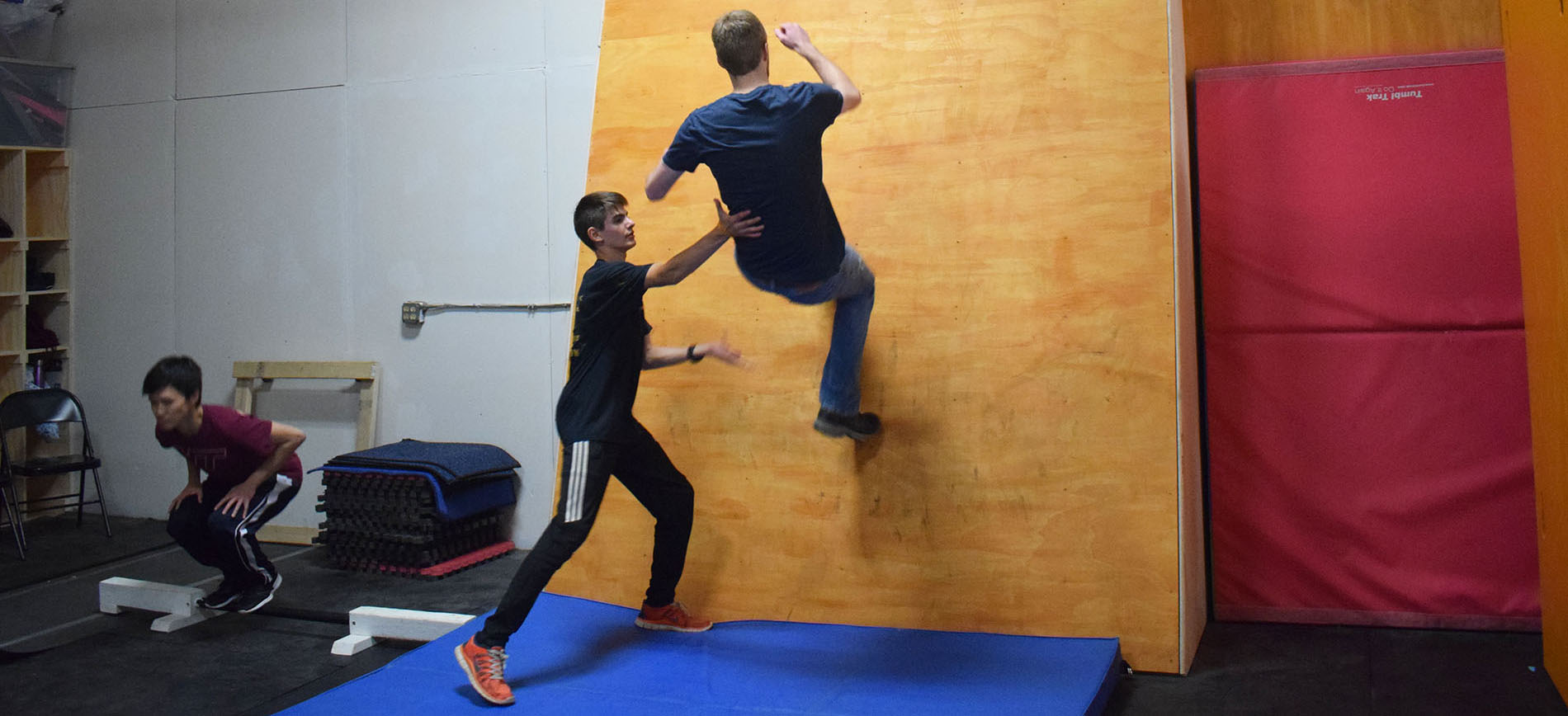 simeon helping Jacob with a wall flip Header